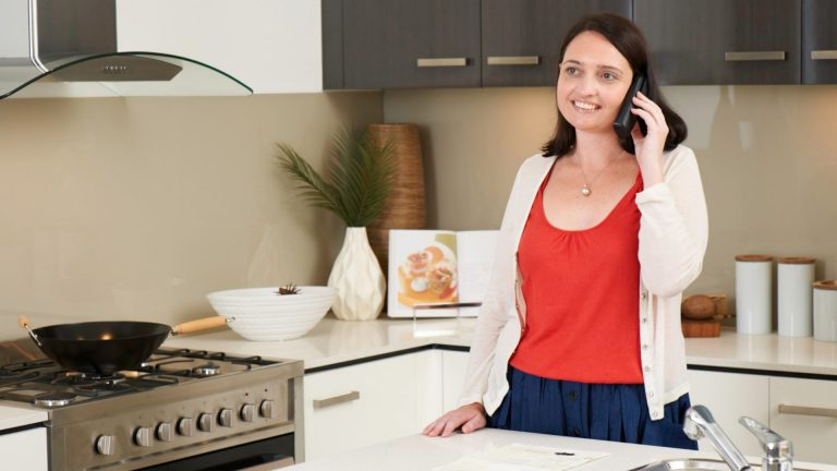 concerned-woman-on-phone-in-kitchen