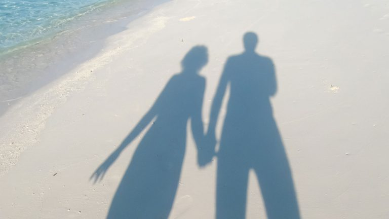 couple beach shadow tall